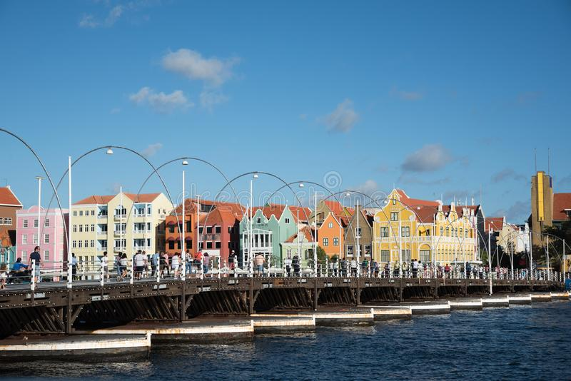 People walking Queen Emma Bridge in Willemstad royalty free stock photography