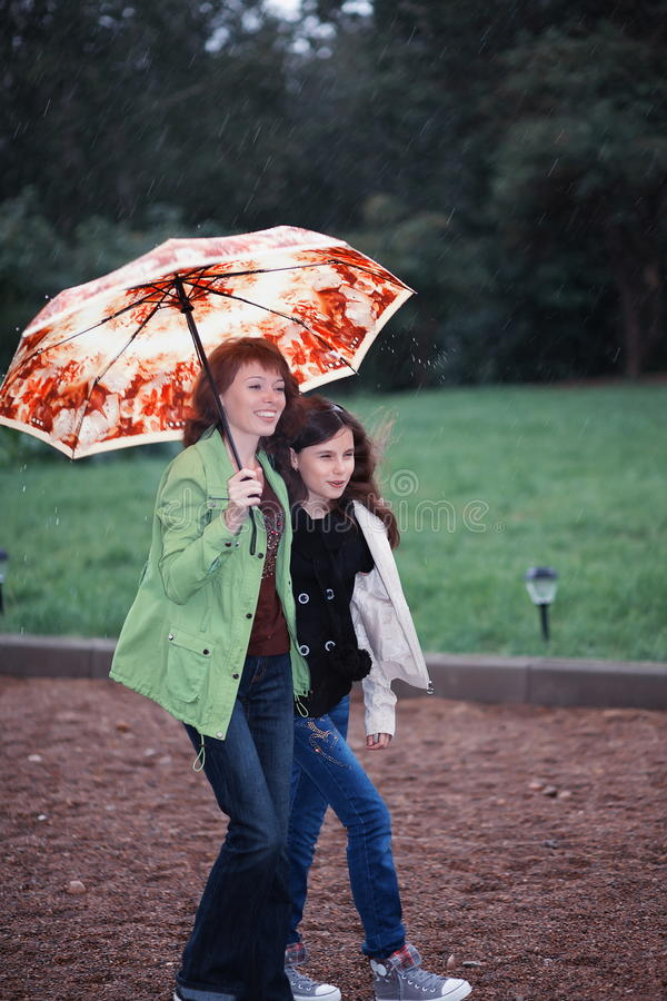 Download People walking in the rain stock photo. Image of mother - 26233482