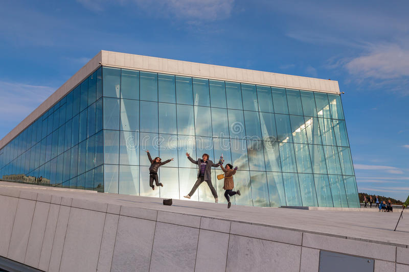 People walking on the roof of the Oslo Opera House royalty free stock image