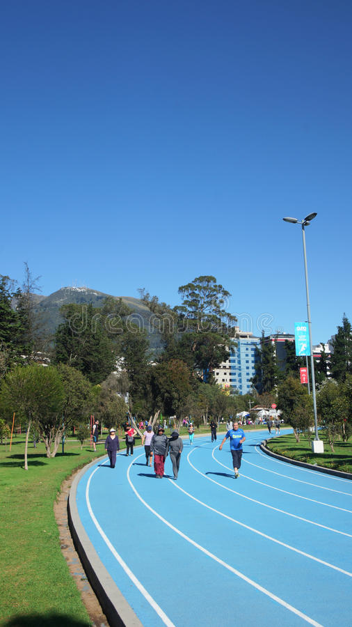 People walking on the running track in the La Carolina Park in the north of the city of Quito royalty free stock photo