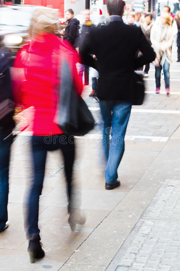 People walking on the sidewalk stock photography