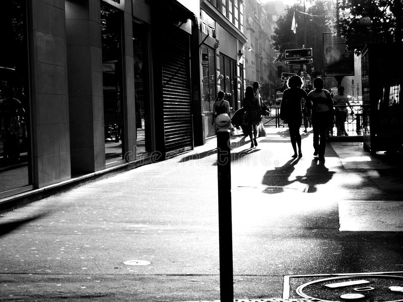 People walking on street black and white. People walking on street of Paris black and white royalty free stock image