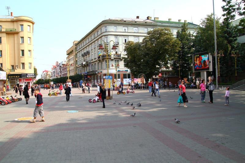 People walking on street stock photo
