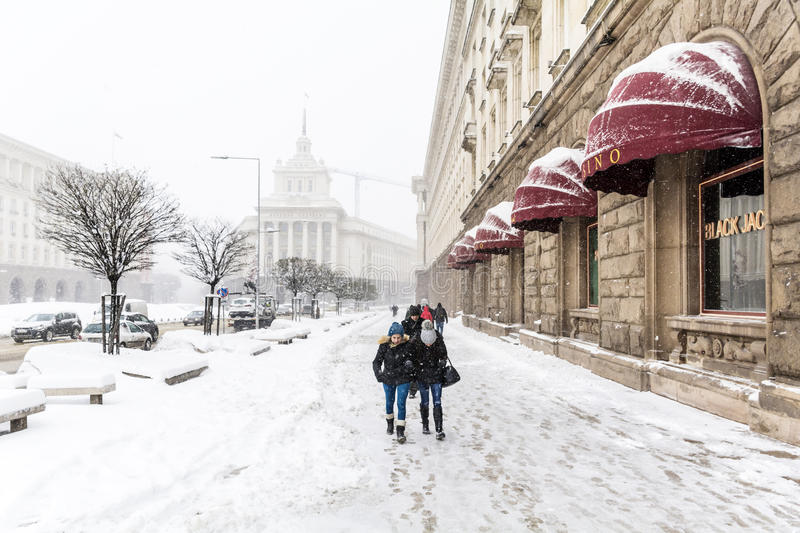 Download People Walking On The Street In A Snowy Day Editorial Photo - Image: 83720256