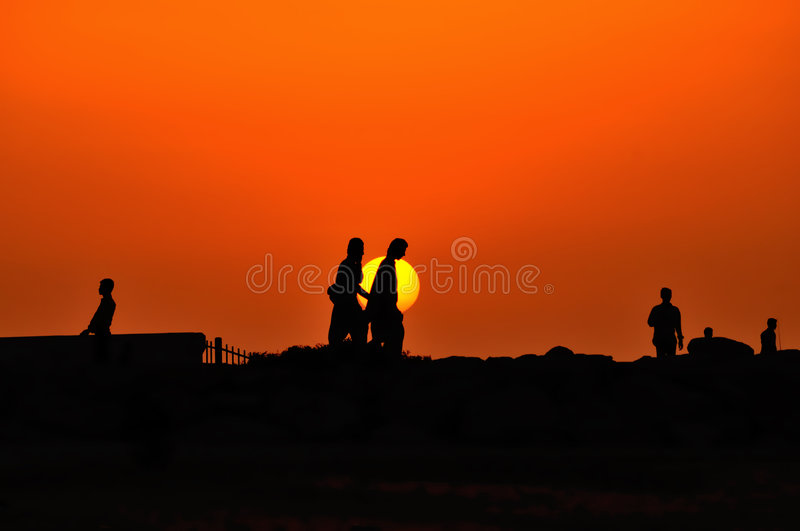 People walking on sunset royalty free stock images