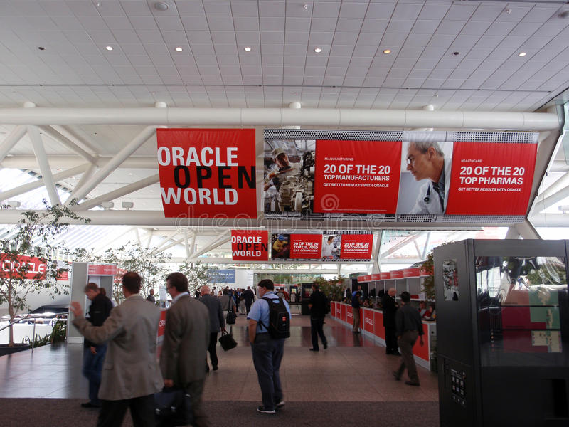 People walking though Oracle Open World Convention royalty free stock image
