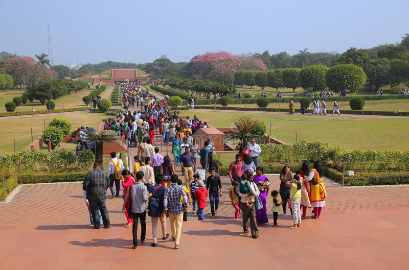 People walking to and from Lotus temple in New Delhi, India royalty free stock images