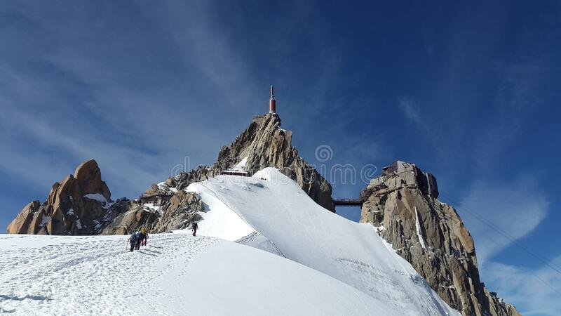 People Walking Toward Top of Mountain on Snow Covered Ground during Daytime stock photos
