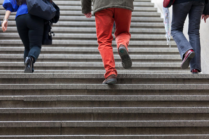 People Walking Up Steps Stock Photography