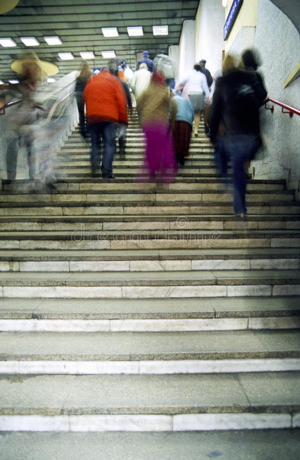 People walking up steps royalty free stock photography