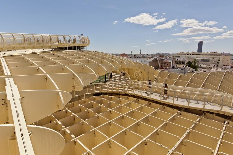 People on a walkway and lookout point on top of the Metropol Parasol, with the city of Seville in the background,  Spain royalty free stock photo