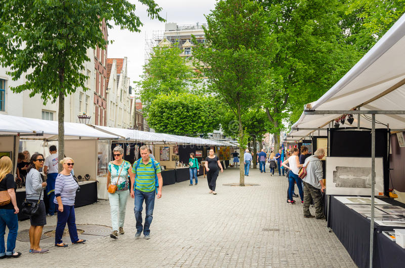 People Wandering around an Art Market in Amsterdam stock image