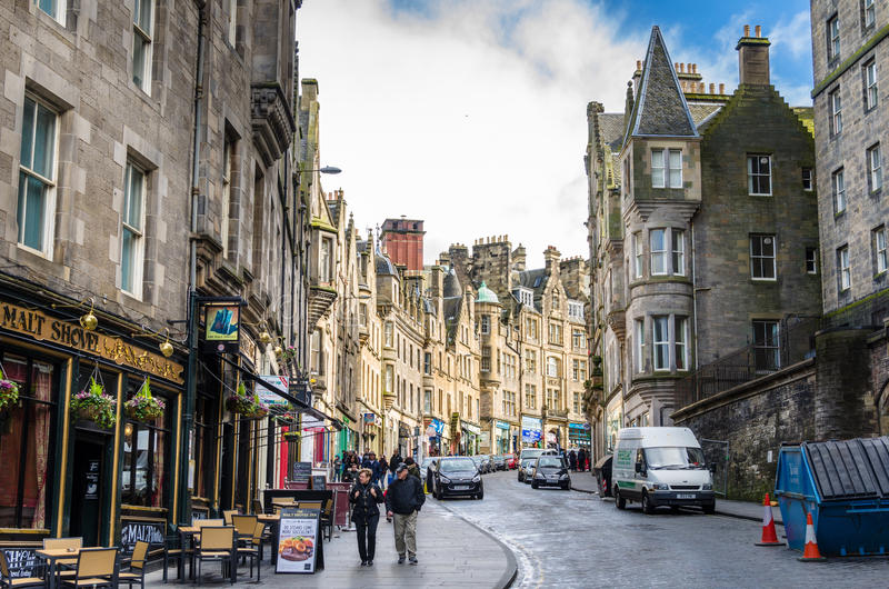 People Wandering around Edinburgh old town on a winter day stock image