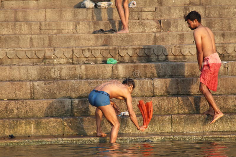 People washing their clothes in Ganges River, Varanasi, India. Varanasi , also known as, Benares, Banaras or Kashi is an Indian city on the banks of the Ganga in royalty free stock photography
