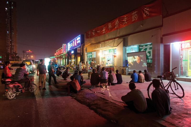 People watch movie at street cinema stock photo