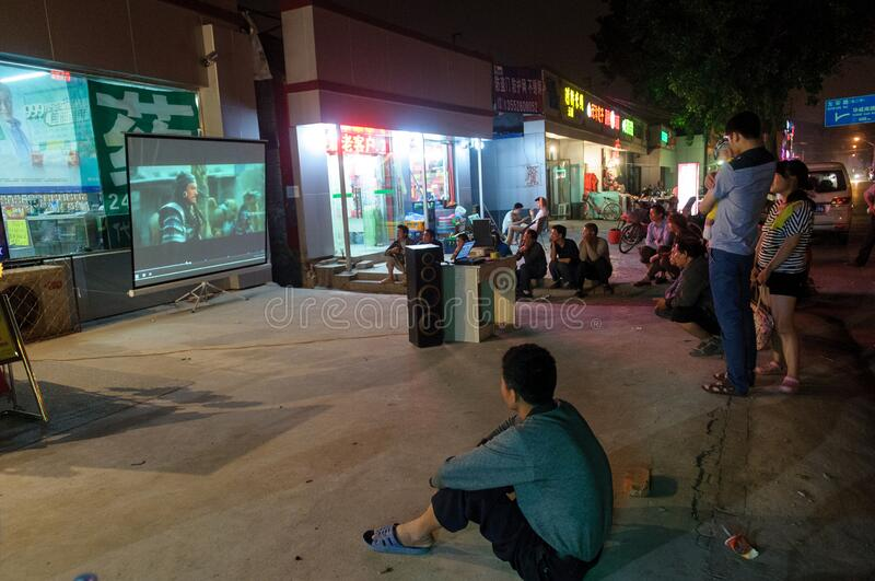 People watch movie at street cinema stock images