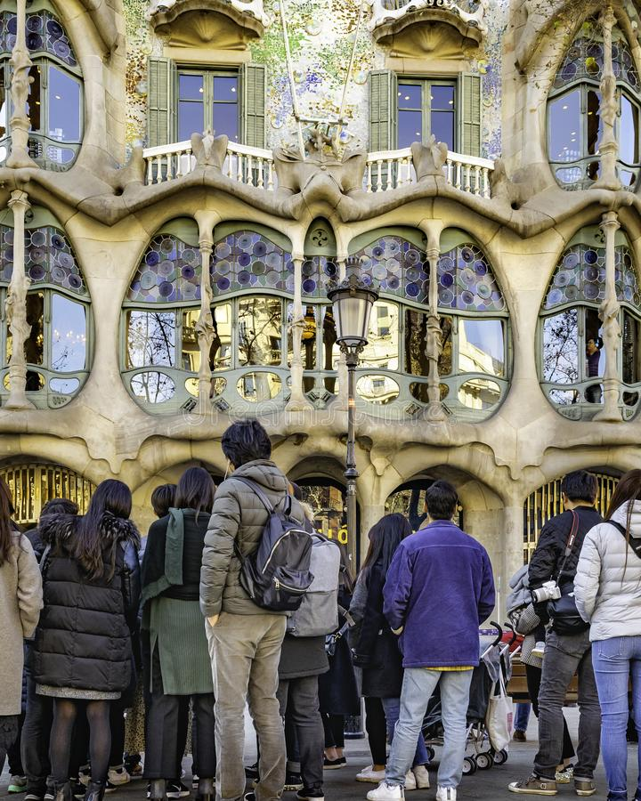 People Watching Batllo House Building, Barcelona, Spain. BARCELONA, SPAIN, JANUARY - 2018 - Crowded watching batllo house, a famous masterpiece atchitecture royalty free stock photo