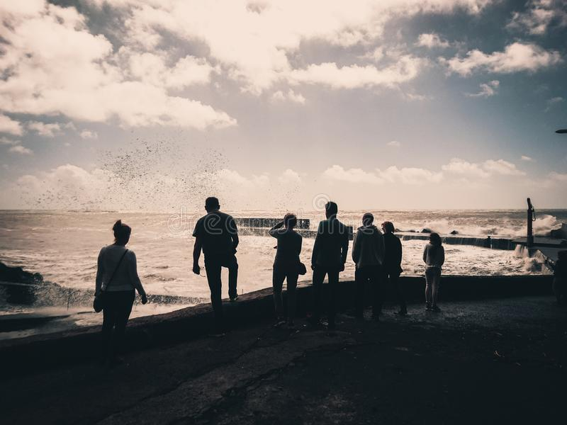 Waves watching on Madeira. People watching big stormy waves on Madeira royalty free stock photos