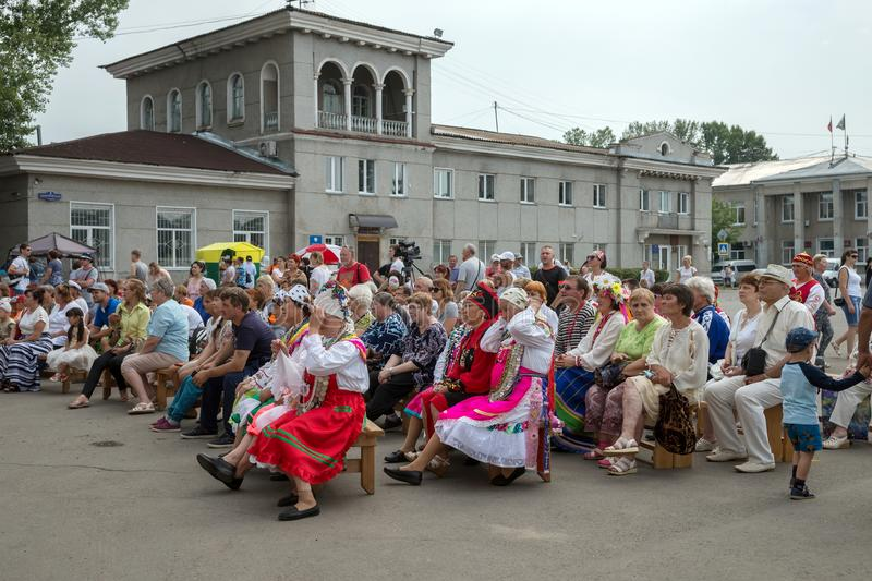 People are watching a concert in the central square of the village at the annual Intl festival of music `World of Siberia`. SHUSHENSKOE, Krasnoyarsk Territory/ stock images