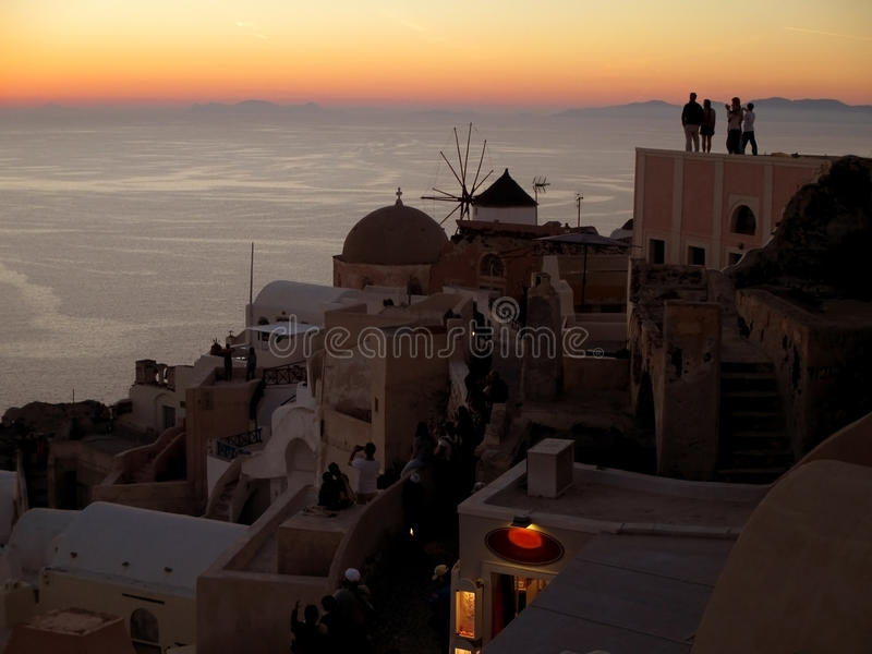 People watching the famous Oia Sunset at Oia village, Santorini Island stock image