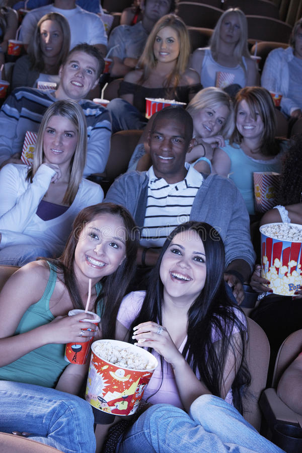 People Watching Film In Movie Theater. Group of multiethnic people watching film in movie theater royalty free stock photography