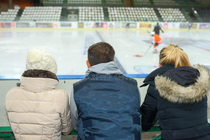 People watching ice hockey game. Ice stock photography