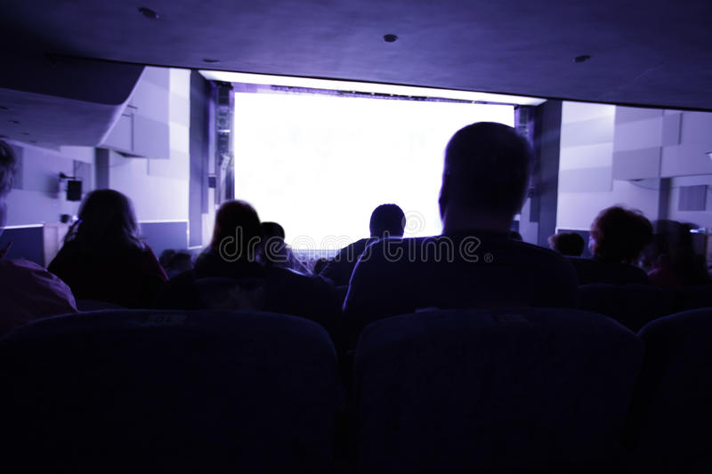 People watching movie royalty free stock photo