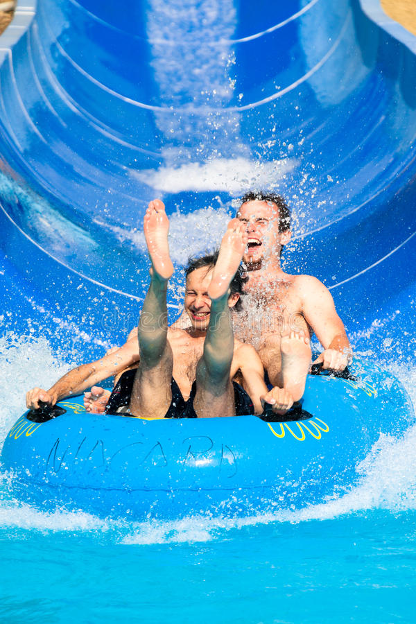 People water slide at aqua park stock photography