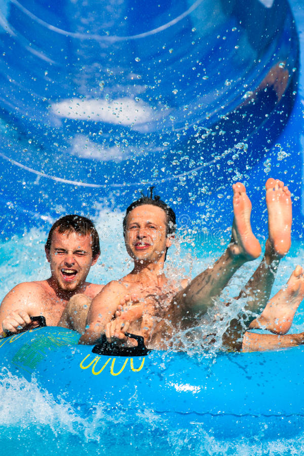 People water slide at aqua park royalty free stock images