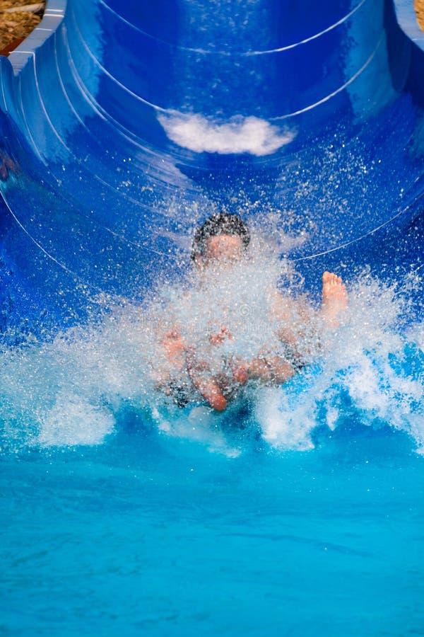 People water slide at aqua park stock image