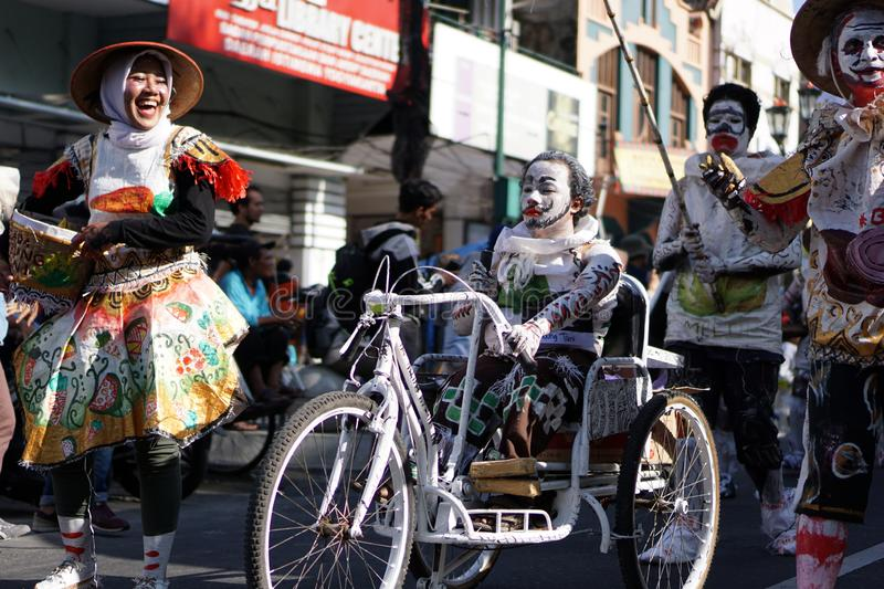 People wear unique and colorful costumes on a carnival on Malioboro street, Yogyakarta, Indonesia stock photos