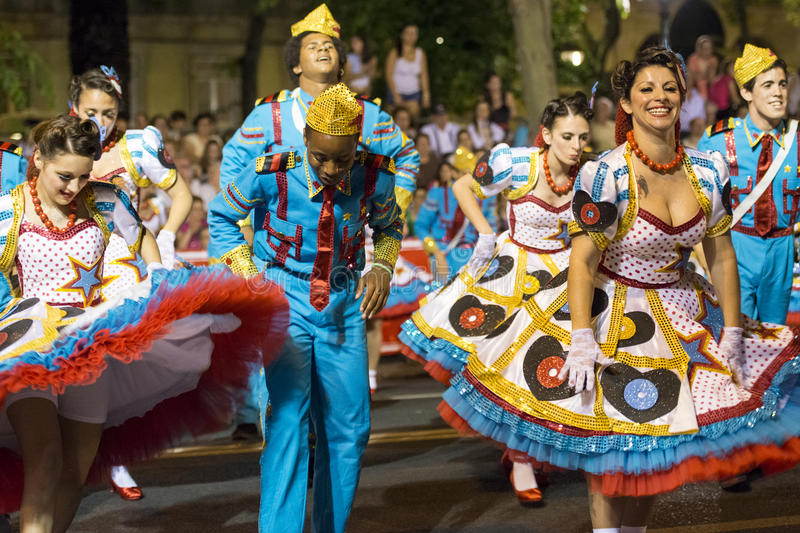 Download People Wearing Costumes At The Parade Of Popular Marches Marchas Populares During The Saint Anthony