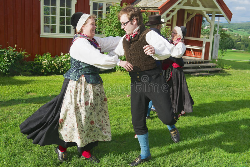 People wearing historical costumes perform traditional dance in Roli, Norway. royalty free stock images