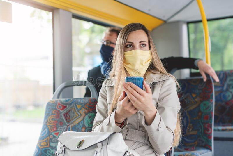 People wearing masks in the bus using public transport royalty free stock photos