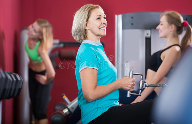 People weightlifting training in modern health club stock photography