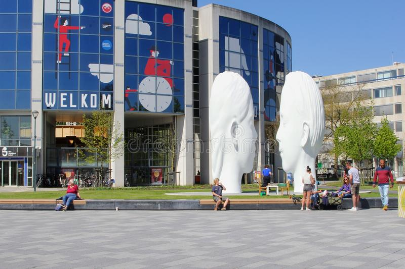 Leeuwarden, Netherlands, May 5 2018, People modern artistic white faces statues arts by Jaume Plensa stock image