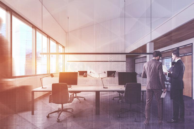 People in white open space office stock photos
