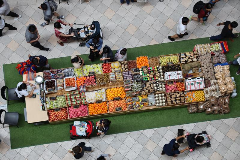 People who buy fruit at the Power plant mall, Makati city, Philippines, Jul 6, 2019. Jul 6, 2019 People who buy fruit at the Power plant mall, Makati city royalty free stock photos