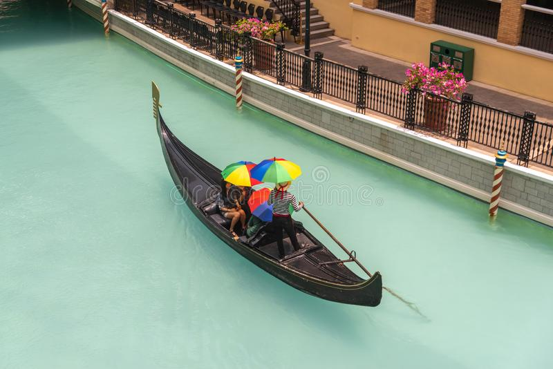 People who enjoy gondolas in the Venice grand canal mall, Metro Manila, Philippines, May 4, 2019. May 4, 2019 People who enjoy gondolas in the Venice grand canal stock image