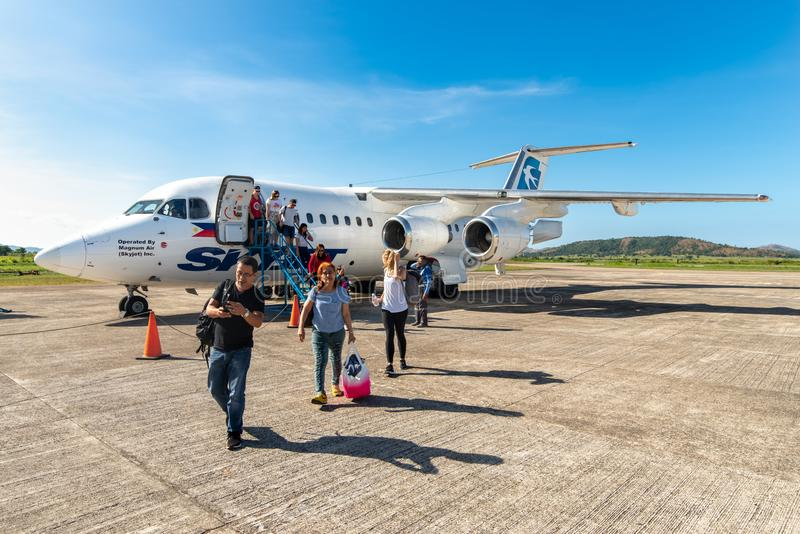 People who get off the plane at Busuanga airport, Palawan, Philippines, Nov 14, 2018 stock image