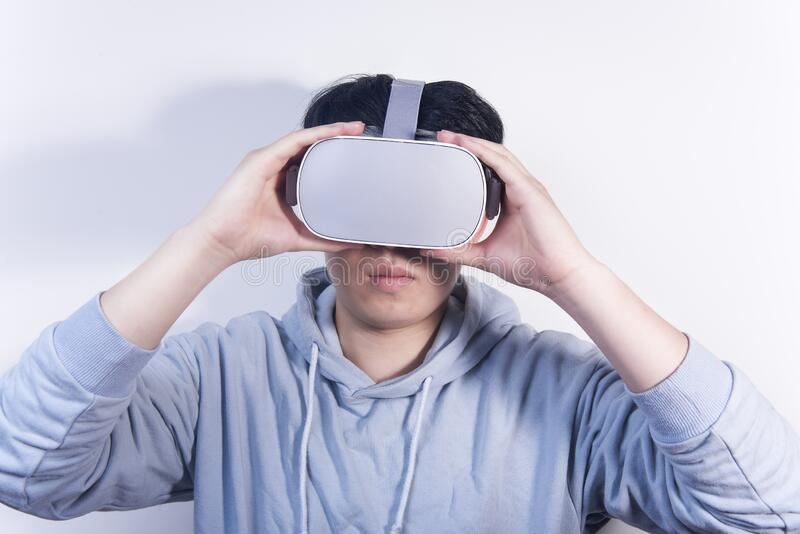 People who are using vr virtual reality and wearing glasses to watch the video.  stock photo