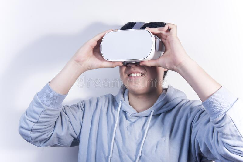 People who are using vr virtual reality and wearing glasses to watch the video.  royalty free stock images