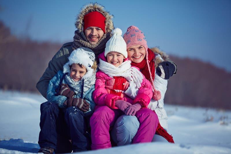 People in winterwear. Happy family of four in winterwear stock image