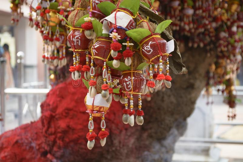 People wish from Goddess Kali hang the decorative pots in the tree smeared with vermillion. By the Hindus in Bargabhima Temple of Tamluk Medinipore, West Bengal stock photos