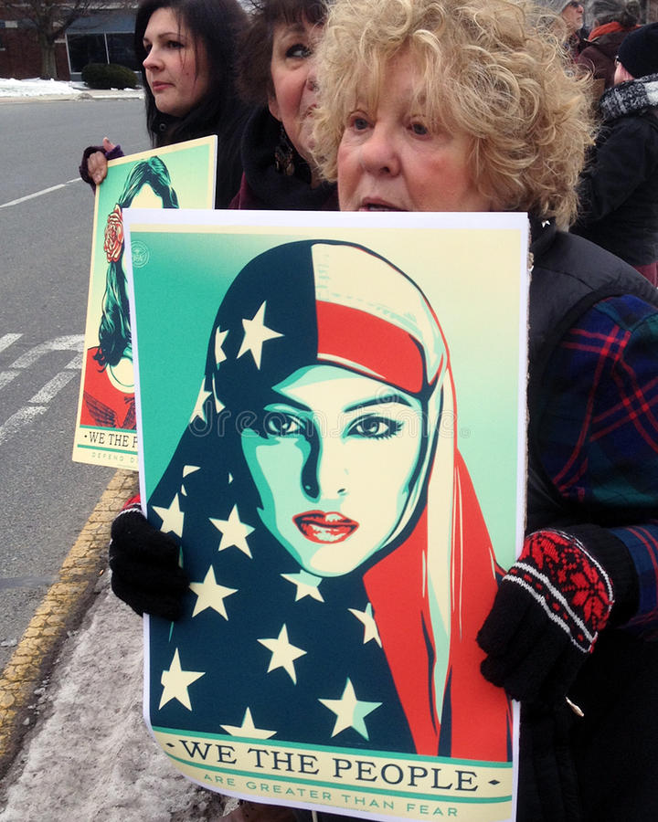 We the people. Women demonstrating in solidarity with immigrants in the United States. `We Stand With Immigrants` event in the small city of Pittsfield stock photos