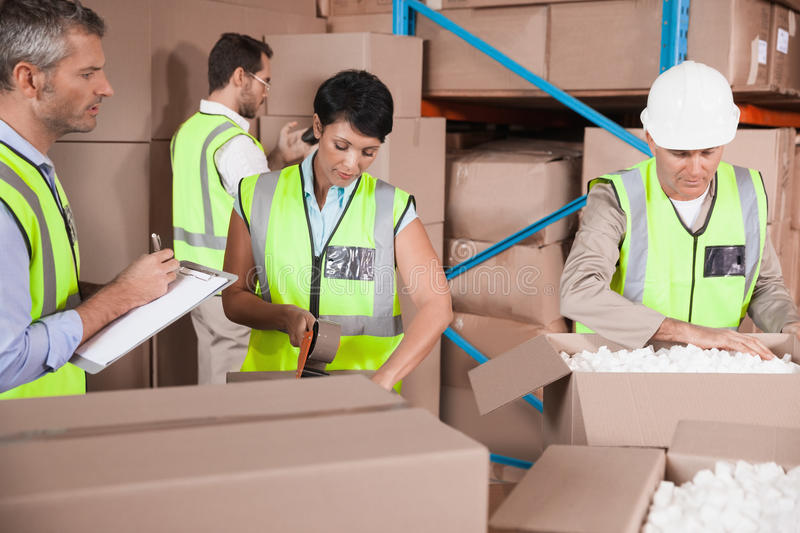 People at work in warehouse stock images