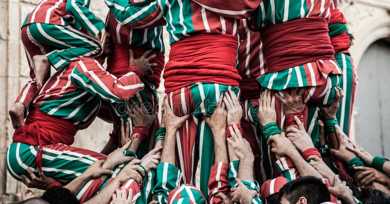 People working as a team building a human tower. In Algemesí, Valencia royalty free stock photography