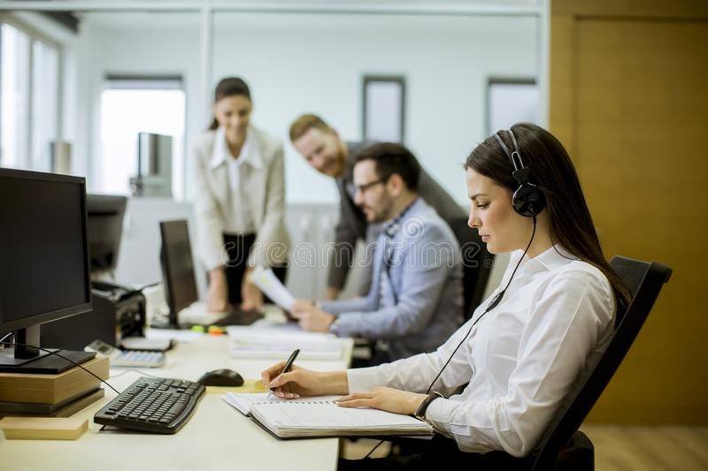 People working in a busy office royalty free stock photo