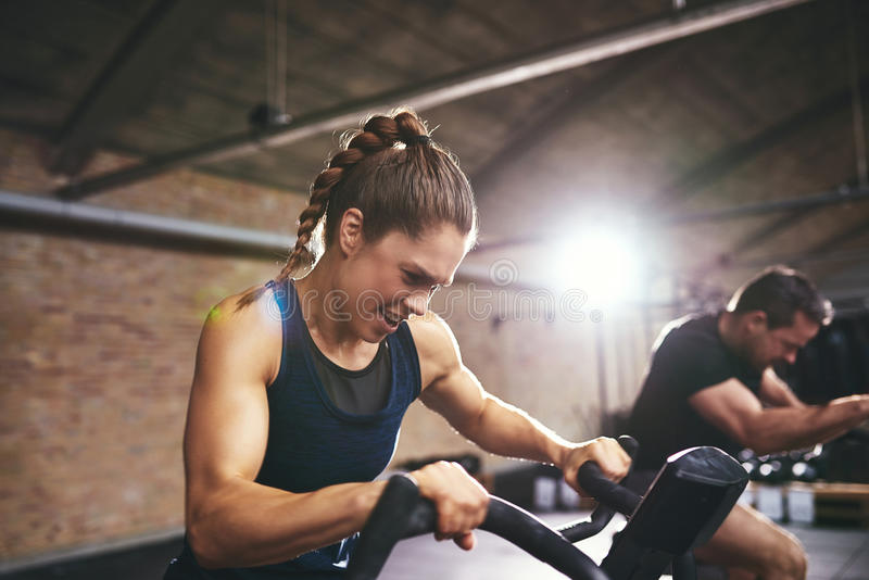 People working exercycle in gym stock photography