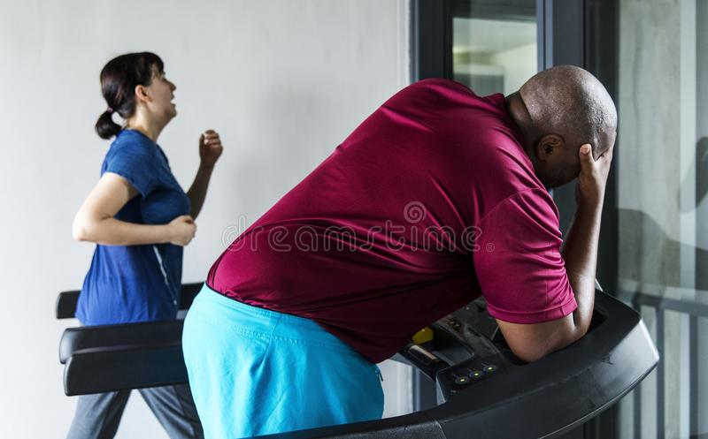 People working out at a gym stock photo